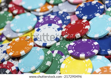 Background created with casino chips. - stock photo