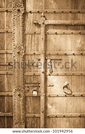 Background detailed image of an old wooden door - stock photo