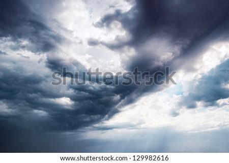 Background Dramatic dark sky with sun rays - stock photo