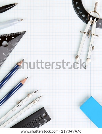 Background - drawing tools on white notebook sheet in the box - stock photo