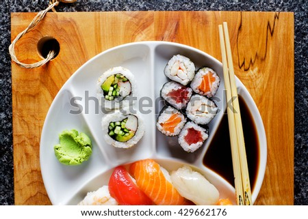 background for sushi restaurant. Sushi Set nigiri and sushi rolls , maki, soy sauce, wasabi, chopsticks - stock photo