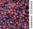 background freshly picked red grapes - stock photo