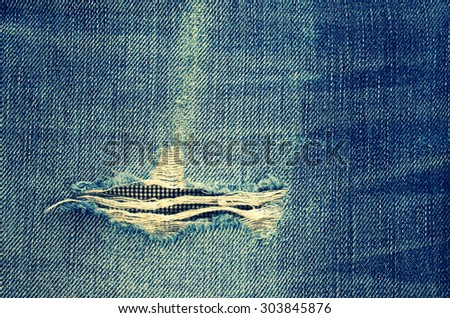 Background from a jeans fabric with a place for an inscription - stock photo