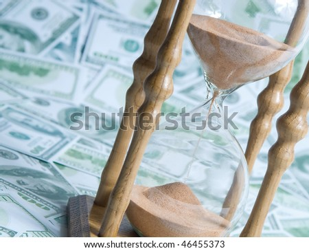 Background from a sand glass and money - stock photo