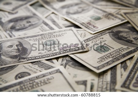 background from chaotically lyings one hundred greenbacks - stock photo