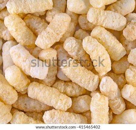 Background from corn sticks with sugar powder. Closeup image. - stock photo