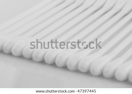 Background from cotton buds on a reflecting surface. - stock photo