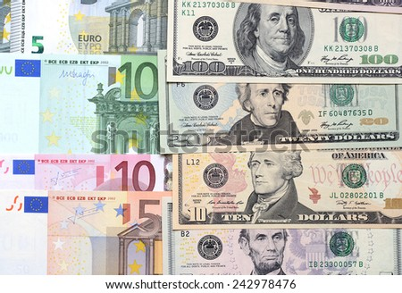 Background from different banknotes of dollars and euro close up. - stock photo