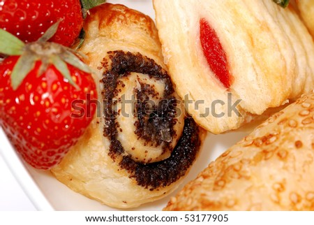 background from fresh buns and  strawberry on a plate