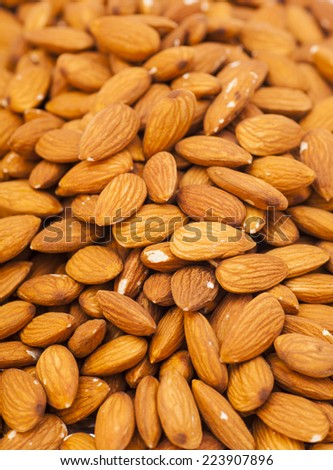 Background from fresh dry peeled almond nuts  - stock photo