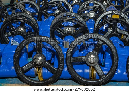 Background from hand wheel of industrial valves ready for dispatch on Euro pallet - stock photo