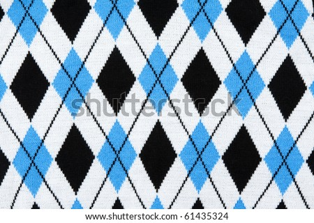 Background from knitted plaid fabrics with pattern - stock photo