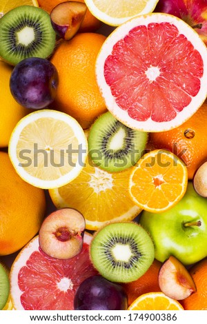 Background from many different exotic fruits - stock photo