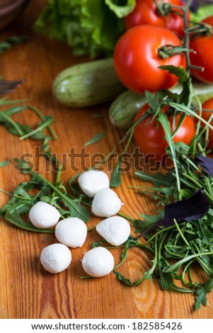 background from mixed vegetables with wooden board