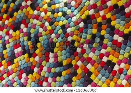 background from multi-colored carpet - stock photo