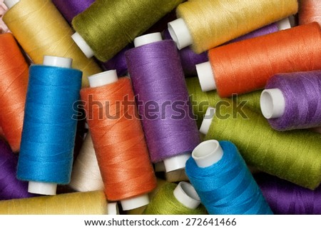 background from multi-colored spools of thread