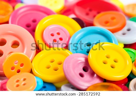 Background from of colorful round buttons, close-up. - stock photo