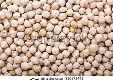 Background from ripe peas chickpeas, closeup top view - stock photo