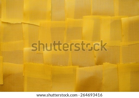 background from small pieces of satin ribbons yellow - stock photo