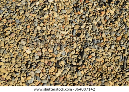 Background from small round crushed stone. A heap from a small pellet. - stock photo