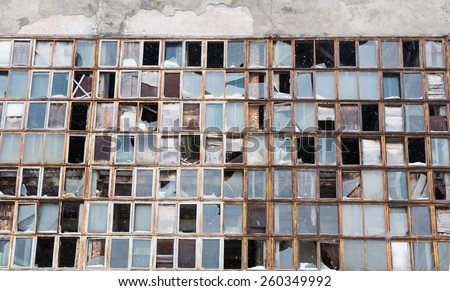 background from the broken windows of industrial - stock photo