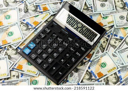 Background from the one hundred dollars banknote and calculator - stock photo