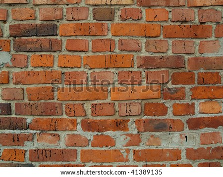 Background from the red old broken bricks and cement - stock photo