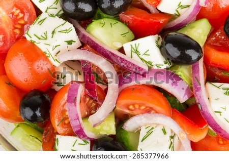 Background from tomatoes, onions, black olives, cucumber and cheese