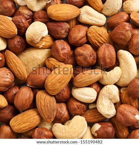 Background from various kinds of nuts (almond, hazelnut, cashew, Brazil nut) - stock photo