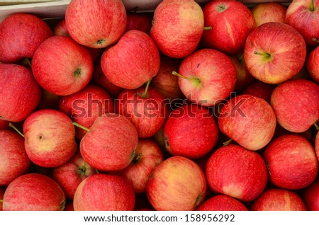 Background - full frame of red apples in wooden crates, ready for sale - stock photo