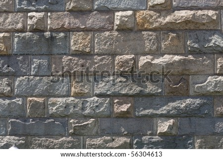 Background, granite block wall, old and weathered - stock photo