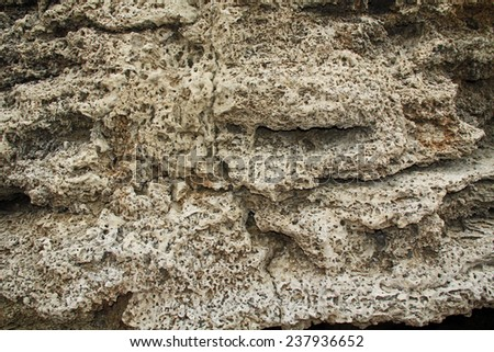 Background grunge texture of wall ruins in Caesarea Maritima National Park, a city and harbor built by Herod the Great about 25-13 BC. The archaeological ruins are on the Mediterranean coast of Israel - stock photo