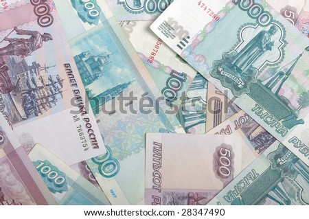 Background image of different russian bank notes - stock photo