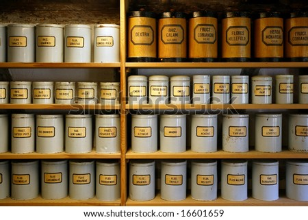 Background image of old pharmaceutical canisters used in creating medicine. Shot with ambient room lighting. - stock photo