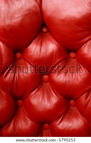 Background image of plush red leather from an antique seat. - stock photo