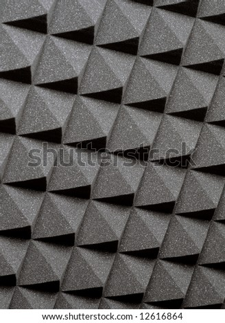 Background image of recording studio sound dampening acoustical foam. - stock photo