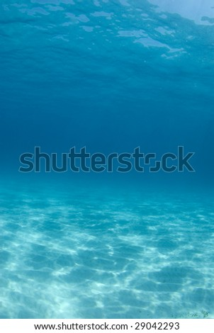 Background image of the rippled sand on the ocean floor at Tiger Beach - stock photo