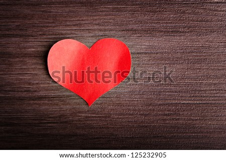 background in the style of Valentine's Day. red heart on a wooden background