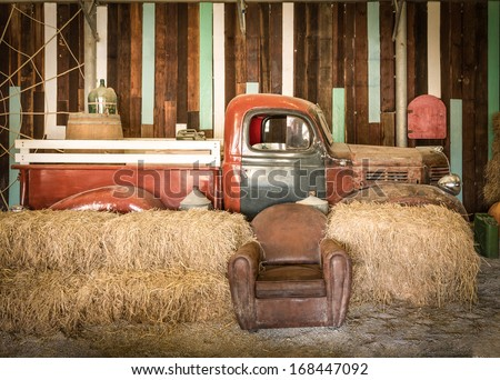 background interior design of an old country house, decorating brown sofa and red pickup inside the room - stock photo