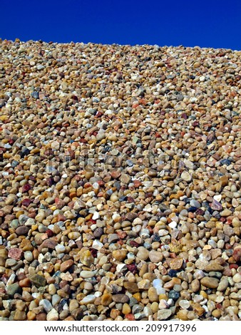 Background made from closeup of a pile of stones, gravel - stock photo