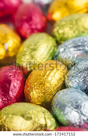 Background made from colorful chocolate Easter eggs - stock photo