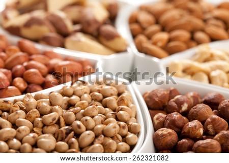 Background made of dried organic healthy fruit (soy, hazelnut, cashew, almond, chickpeas, peanut) - stock photo