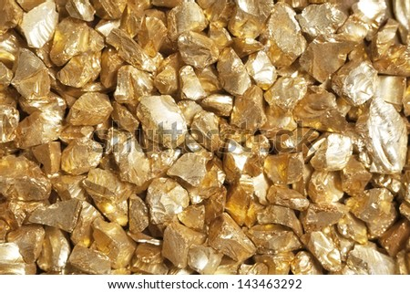 Background made of golden nuggets, symbol of safe investment. - stock photo