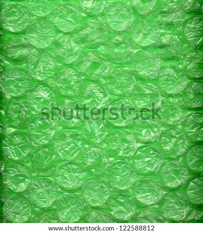 Background made of green bubble wrap or packing material - stock photo