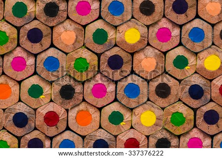 background made of macro shoot of multicolored pencils - stock photo