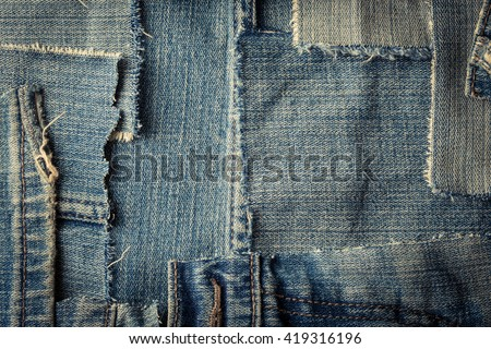 background made of old jeans rags close up - stock photo