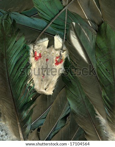 Background made of raven feathers with object for witchcraft - stock photo