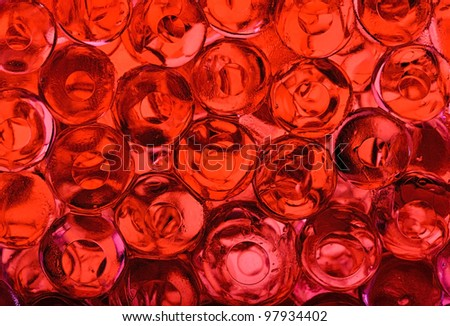 Background made of red gel water pearls - stock photo