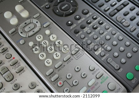 background made of several remote controls - stock photo