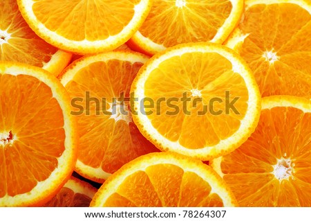 background made of sliced juicy oranges - stock photo